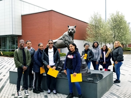 Loughlin Visits Adelphi College